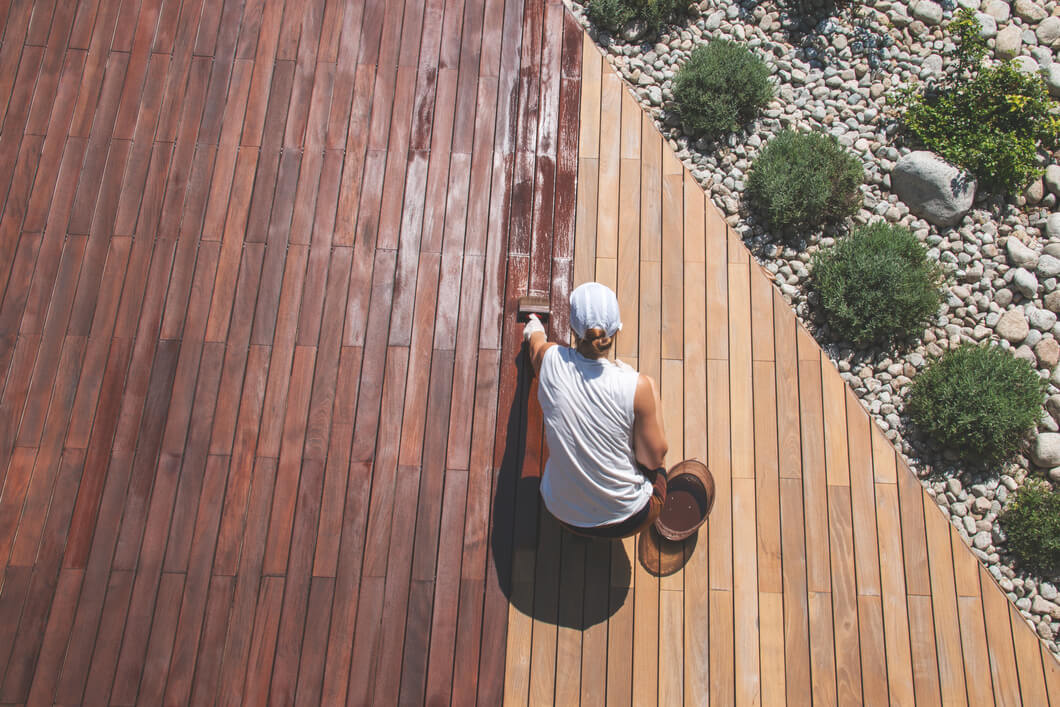 Person staining a Deck
