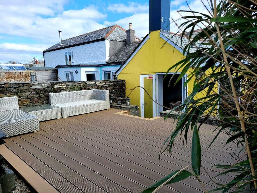 Yellow building with teak deck
