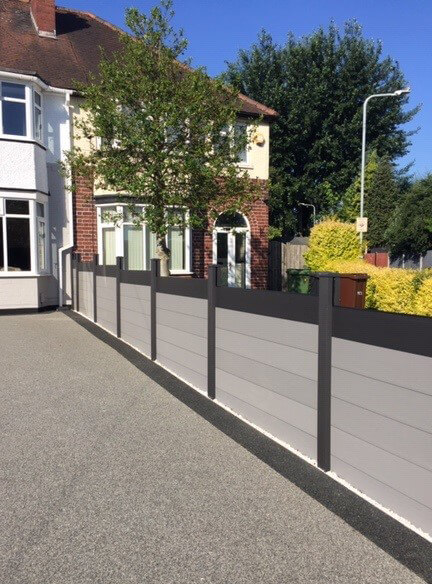 Fencing Installation using Cladco Charcoal Composite Posts and Caps paired with Light Grey Composite Fence Panel