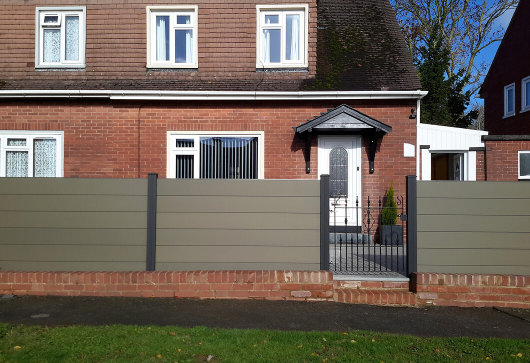 Long Fence using Cladco Composite Olive Green Fence Panels