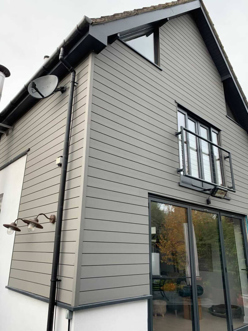 House clad in Cladco Composite Stone Grey Wall Cladding Boards