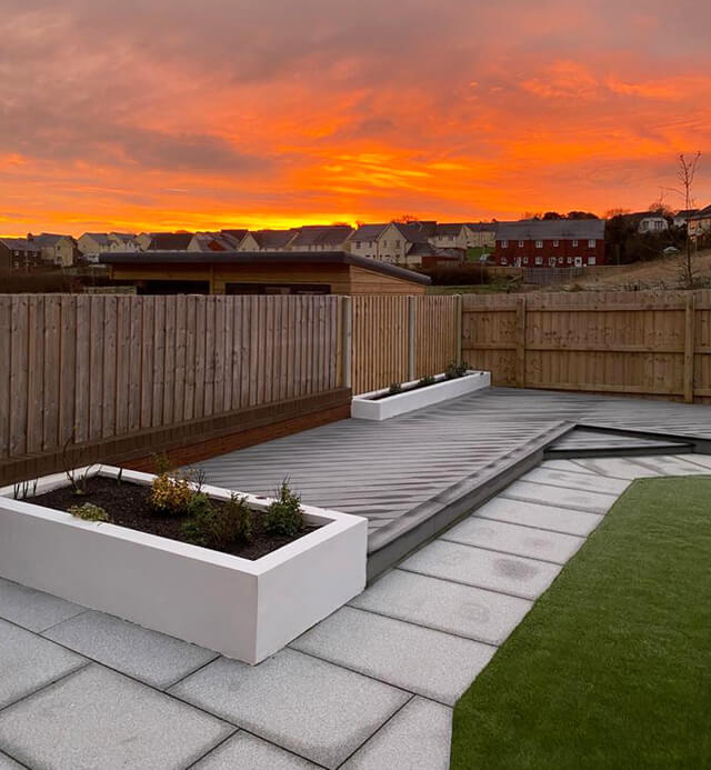Decking combined with stone pavings