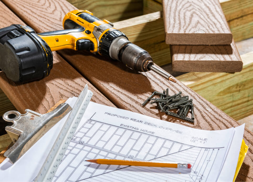 Power Drill on decking with screws and design drawing